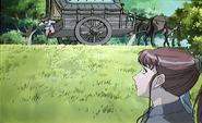 Youko looking at caravan