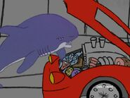 Shark checking the insides of his red car