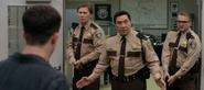 S04E10-Graduation-025-Bill-Diaz-cop