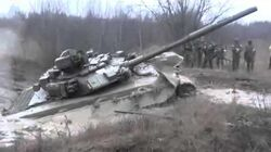 Tanks_are_not_afraid_of_mud?_Russian_tank_T_90_stuck_in_the_mud_Documentary_video