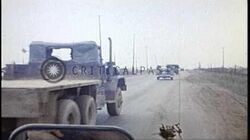 Army_jeeps_enter_Camp_Holmes_at_Phu_Bai_Combat_Base_during_US_3rd_Brigade,_82nd_A...HD_Stock_Footage