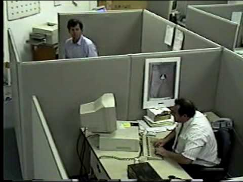 man destroys his keyboard and monitor