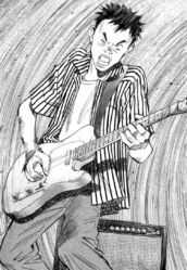 Kenji playing the guitar