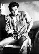 Young-johnny-depp-smoking-wearing-jeans-jacket-photo-u1