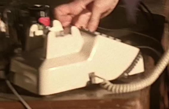 1x08 barn phone.jpg