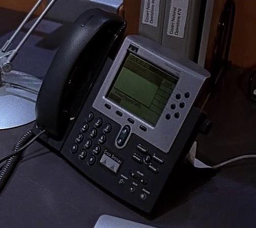 1x08 Jamey desk phone.jpg