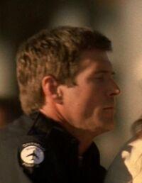 5x03 airport cop.jpg