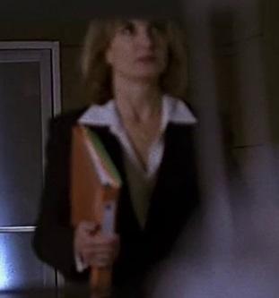 1x14 blond woman with folder.jpg