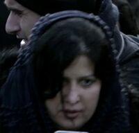 9x03 female protestor shawl.jpg