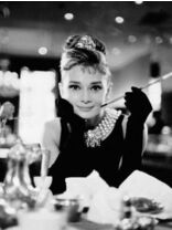Audrey Hepburn doing a promotional photoshoot for her film Breakfast At Tiffany's as Holly Golightly.