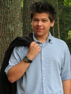 6942-a-young-latino-teen-boy-posing-outdoors-by-a-tree-pv