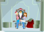 Jen and Caitlin sitting on Jonesy Claus's lap