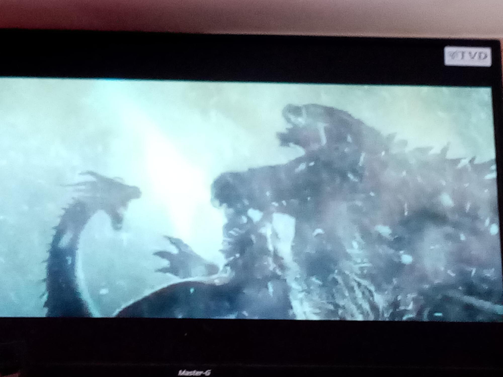 Aquí viendo como Godzilla le saca la madre a Ghidorah