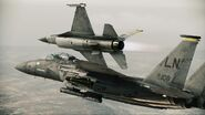F-15E Strike Eagle and F-16C Fighting Falcon breaking