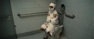 Greg Heffley in the bathroom covered in toilet paper