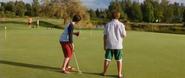 Greg and Rowley golfing