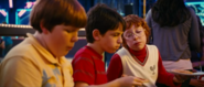 Rowley, Greg, and Fregley eating pizza