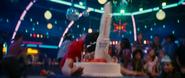 Greg facepalms into a rocket cake