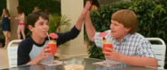 Greg and Rowley high-fiving each other after getting smoothies