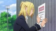 Ryo putting up a poster