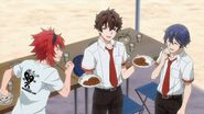 Kai offering a plate of curry to Saku and Mike