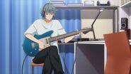 Sosuke playing with his guitar