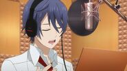 Saku singing in the studio
