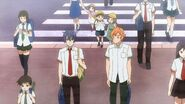 Hinata and Saku looking at the school from the entrance