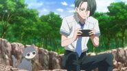 Chiguma playing his game with a cat near him