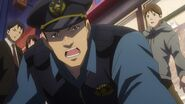 A police officer telling Ryo let's hear what you have to say back at the station