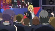 Ryo handing the microphone to the crowd