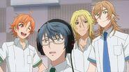Hinata winking with Mitsuki, Ryo, and Satsuma amazed by Saku's singing