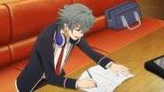Sosuke writing and composing music on his notebook