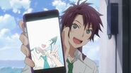 Kakeru showing Saku, Sosuke, and Uta a picture of his little sister