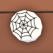 Eco White Spider Web Badge on the wooden board