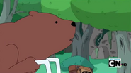 S4 E7 Bear passing by a ruined building