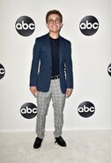 Sean Giambrone in a suit
