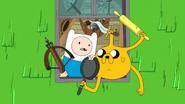 S7e33 Finn and Jake wielding weapons