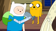 S9e2 Finn and Jake looking at goblet