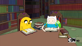 S2e15 finn and jake reading in library