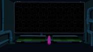 S6e22 PB standing in front of darkened screens