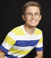 Sean Giambrone in yellow and blue shirt