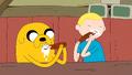 S5e10 Finn and Jake eating sassages