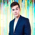 Jeremy Shada backed with a neon background