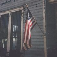 Old American Flag on an Old Buildng