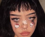 Girl with bangs and Kuromi stickers and black tears