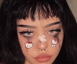 Girl with bangs and Kuromi stickers and black tears.jpg