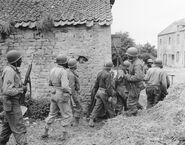 A Platoon of (african-american) Troops Surrounds a Farm House in a Town in France, as They Prepare to Eliminate a German Sniper Holding up an Advance, Omaha Beachhead, near Vierville-sur-Mer, France