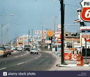 D1970s-suburban-shops-fast-food-motels-gas-busy-clutter-signs-americana-DBXBCN