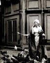 Duchess-of-Devonshire-feeding-chickens-in-ballgown